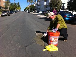 Primo Vannicelli fixes a pothole in Hillcrest, San Diego, CA on Nov. 19, 2010. Photo courtesy of voiceofsandiego.org.