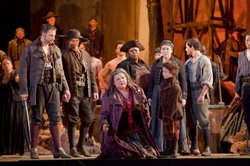 "Dolora Zajick as Azucena, surrounded by the cast of ""Il Trovatore."""