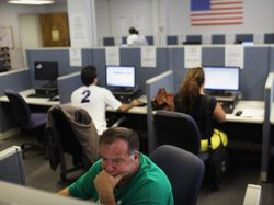 People search for jobs at the Suffolk County One-Stop Employment Center in Ha...