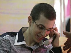 Israeli soldier Gilad Shalit talks to his parents on the phone at an undisclosed location soon after being released from captivity Tuesday.