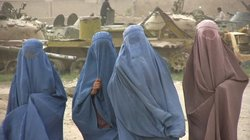 Afghan women in burqas walk the streets of Kandahar, September 16, 2010.