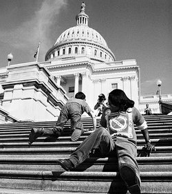 ADAPT protesters climb the steps to the Capitol on March 12, 1990.
