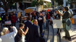 Occupy San Diego protesters regroup in front of a Wells Fargo bank in downtown San Diego after police forced them to leave Civic Center Plaza, October 28, 2011.