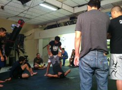 San Diego fighter, Alex Soto, gives some grappling tips to MMA students in Tijuana.