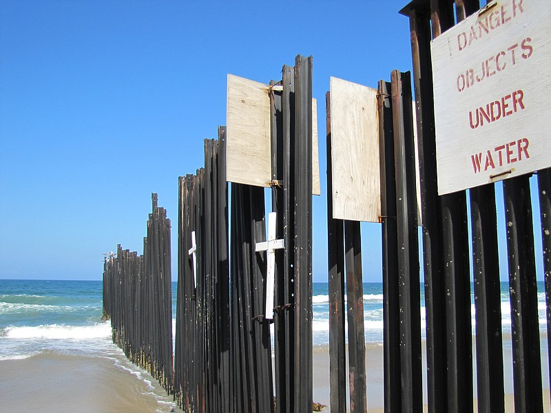 The current border fence where the U.S.A. and Mexico meet at the Pacific Ocean.