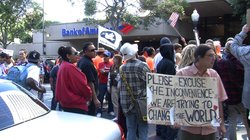 Protesters march on 5th and B in downtown San Diego to urge bank customers to transfer their money to credit unions on Nov. 2, 2011.