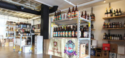 The interior of Bottlecraft in Little Italy, which features a boutique beer shop and a tasting room.