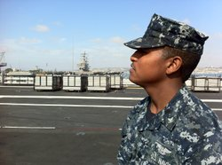 Sailor Richard Steel surveys the deck of the USS Carl Vinson