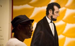 Bill T. Jones studies a portrait of Abraham Lincoln.