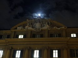 The moon shines as it rises above Italy's finance and economy ministry in Rom...