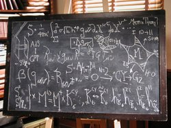 Equations for string theory and general relativity are displayed on a blackboard as a visual reminder that the ideas underlying these theories are grounded in mathematics.
