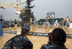 Members of North Carolina Tar Heels practice for the Carrier Classic NCAA college basketball game aboard the USS Carl Vinson on November 10, 2011 in San Diego, California.