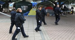 Oakland police officers patrol the Occupy Oakland encampment on November 12, 2011 in Oakland, California.