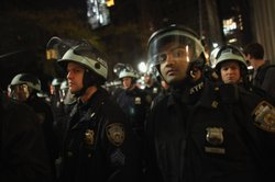 New York City Police face off with Occupy Wall Street protesters after police...