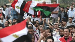 Egyptians attend a rally calling for a rapid transition from military to civi...