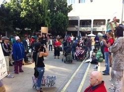 Protesters rally at an Occupy San Diego meeting in Civic Centre Plaza on Nov. 16, 2011.