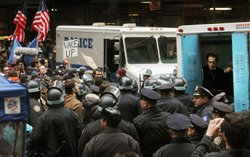 A protester affiliated with Occupy Wall Street sits in a police vehicle after...