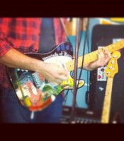 "Tim's whimsically painted ""University of Mars"" guitar."