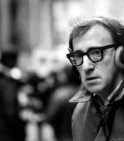 Woody Allen with head phones on the street