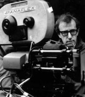Woody Allen directing next to a camera.