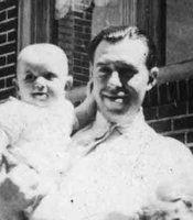 Woody Allen's father, Martin Konigsberg, with baby Woody.