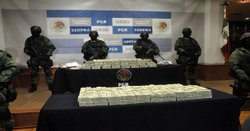 Mexican soldiers stand guard around the seizure of more than $15 million in T...