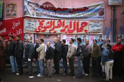 Voters line up outside a polling station on November 28, 2011 in Cairo, Egypt.