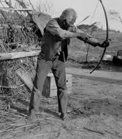 Jim McCarty with bows and arrows, Campo Reservation, Campo Kumeyaay Nation, 1918.
