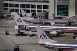 American Airlines planes sit on the tarmac at Miami International Airport on ...
