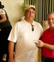 Joe Mulcahy with Tom Karlo upon receiving 1st Place Award.  Desert View Auto Auctions took the top honor with a score of 63.