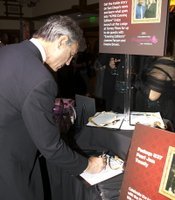 Guests did their bidding in support of KPBS at the silent auction tables.