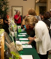 KPBS supporters bidding on their favorite silent auction package