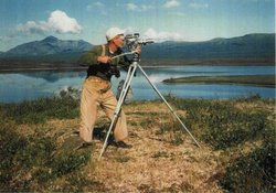 Dick Proenneke with his 16mm wind-up Bolex camera, capturing the stunning Ala...