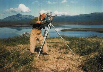 Dick Proenneke with his 16mm wind-up Bolex camera, capturing the stunning Alaskan wildlife and scenery.