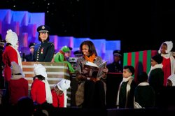 First Lady Michelle Obama and Kermit the Frog read