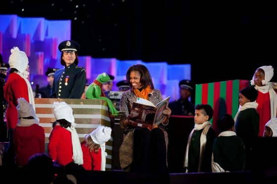 "First Lady Michelle Obama and Kermit the Frog read ""Twas the Night Before Christmas"" to a group of children during the National Christmas Tree Lighting ceremony on the Ellipse in Washington, Dec. 1, 2011."