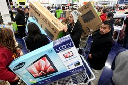 Customers shop for electronics items during 'Black Friday' at a Best Buy stor...