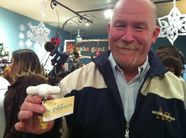 Marshal Ouimett with his Cash Mob purchase from Make Good.