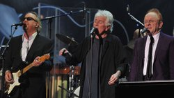 Boz Scaggs, Graham Nash and Peter Asher perform during the concert held at Hollywood's Music Box Theatre in celebration of what would have been Buddy Holly's 75th birthday, September 7, 2011.