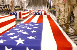 Caskets bearing the remains of U.S. servicemen are shown in the cargo hold of a transport plane at Dover Air Base in this undated handout photo released April 28, 2005 by the Pentagon.