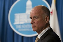 Gov. Jerry Brown discusses mid-year trigger cuts to the state budget at a Cap...