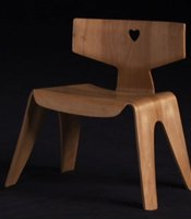 Molded plywood children's chair designed by Charles and Ray Eames.