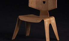 Molded plywood children's chair designed by Cha...