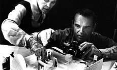 Ray and Charles Eames photographing an early mo...