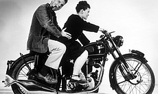 Charles and Ray Eames posing on a Velocette motorcycle, 1948.
