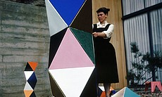 Ray Eames with an early prototype version of The Toy, made of cardboard triangles; outside the Eames House, 1951.