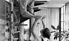 Ray and Charles Eames at home, circa 1970.