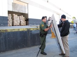 Federal law enforcement agents prepare to show the public drugs seized from a...