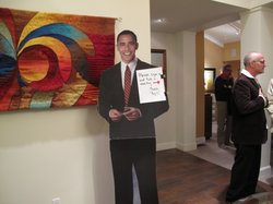 A life-size cardboard cutout of Barack Obama welcomes Democratic Party activi...