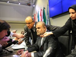 Reporters interview Iranian Minister of Petroleum Rostam Ghasemi before the s...